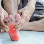 Man with foot pain needs plantar fasciitis treatment in Waterloo